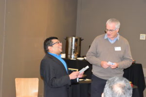 Ayman interacts in fascination with a Rotarian.